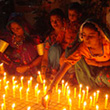 Activists light candles to mark the International Women's Day in Hyderabad, Pakistan © EPA/NADEEM KHAWER