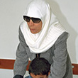 A student is assisted by a blind teacher © UN Photo/Evan Schneider